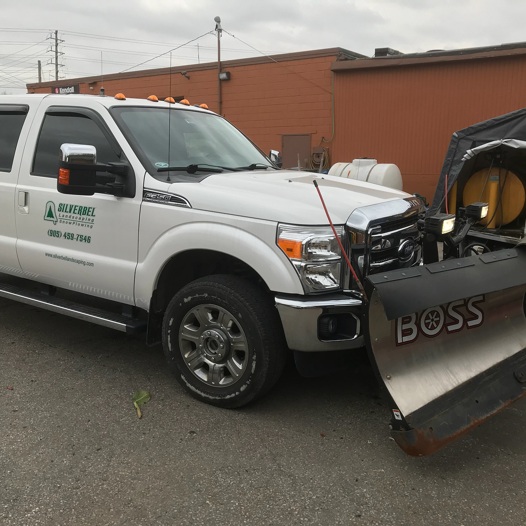 Summer landscaping services truck - Silverbel Landscaping & Snowplowing